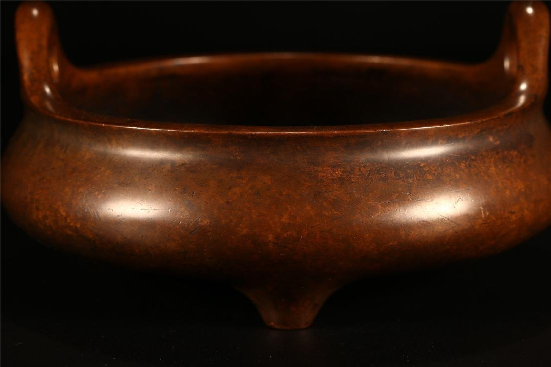 A CHINESE BRONZE DOUBLE HANDLED TRIPOD CENSER - 2