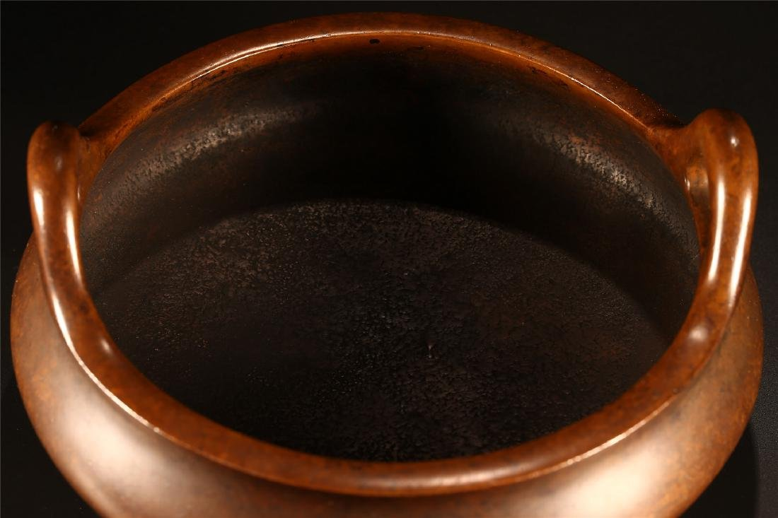 A CHINESE BRONZE DOUBLE HANDLED TRIPOD CENSER - 4