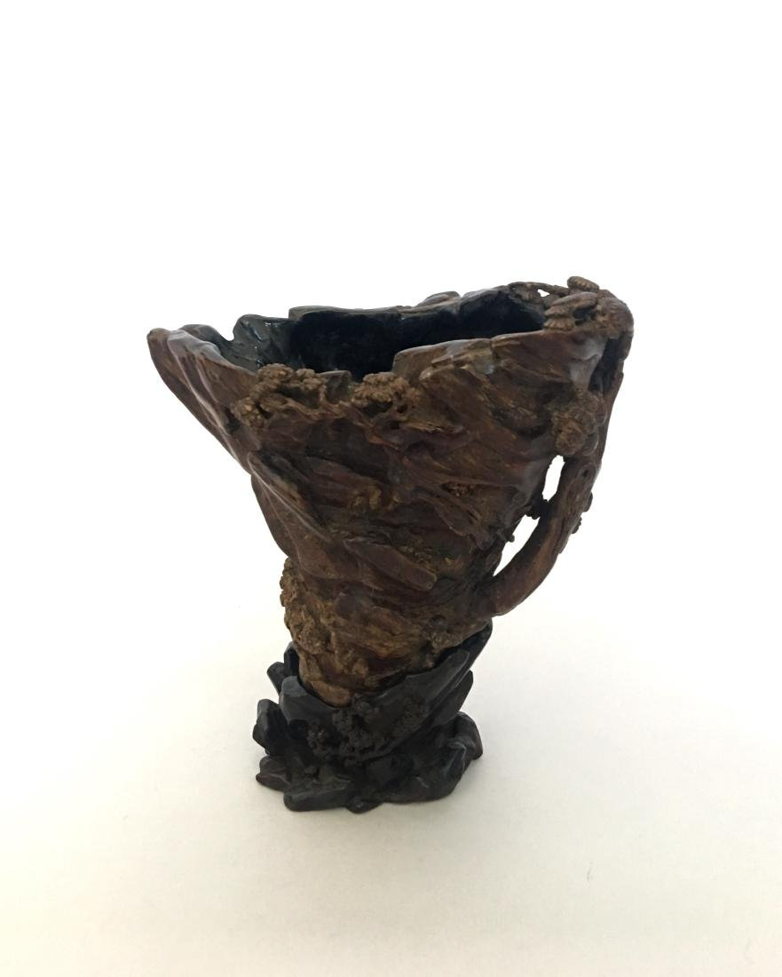 """A CHINESE AGARWOOD """"HORN"""" VESSEL WITH ZITAN STAND"""