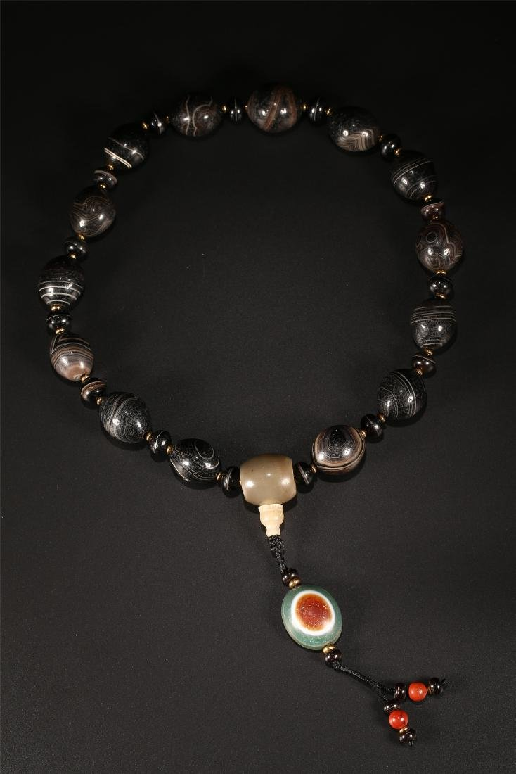 A SET OF CHINESE AGATE PRAYER BEADS
