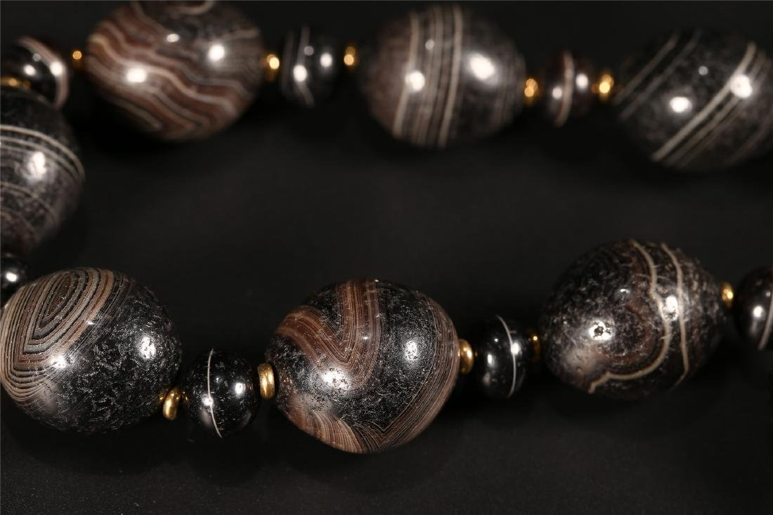 A SET OF CHINESE AGATE PRAYER BEADS - 9