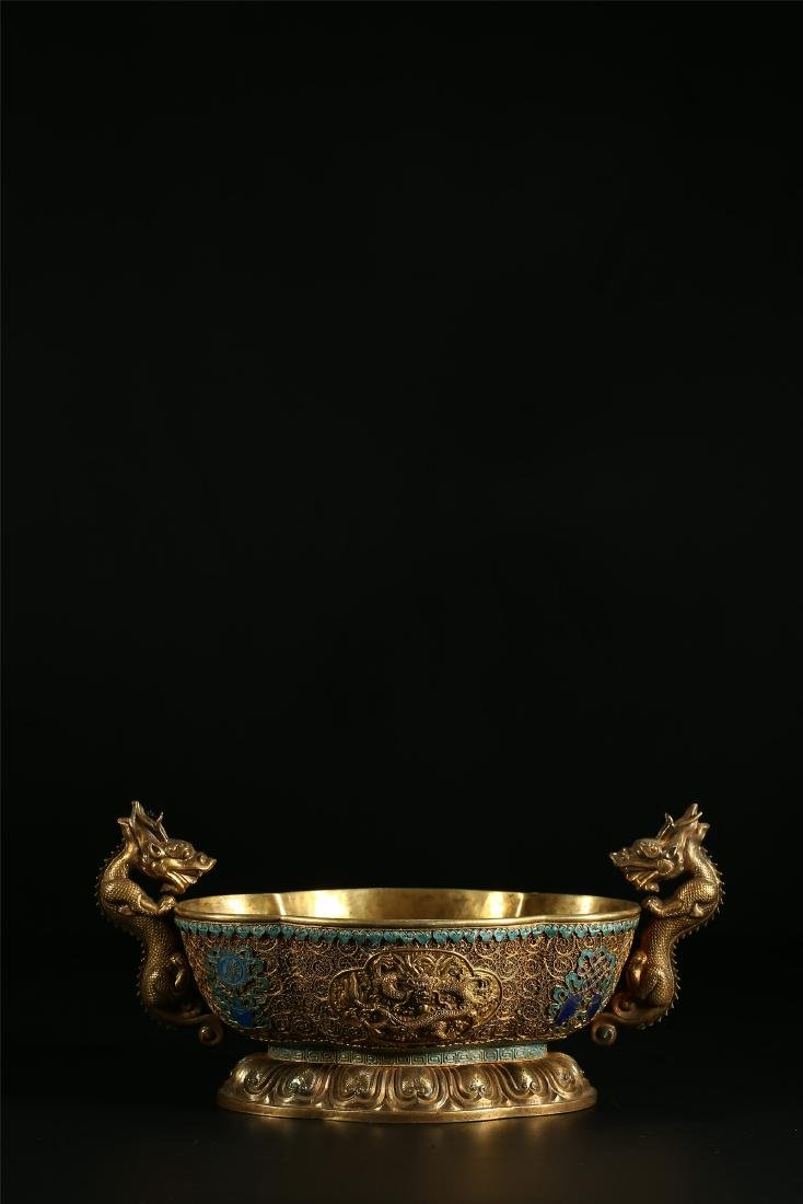 """A CHINESE GILT SILVER DOUBLE """"DRAGON"""" HANDLED BOWL"""