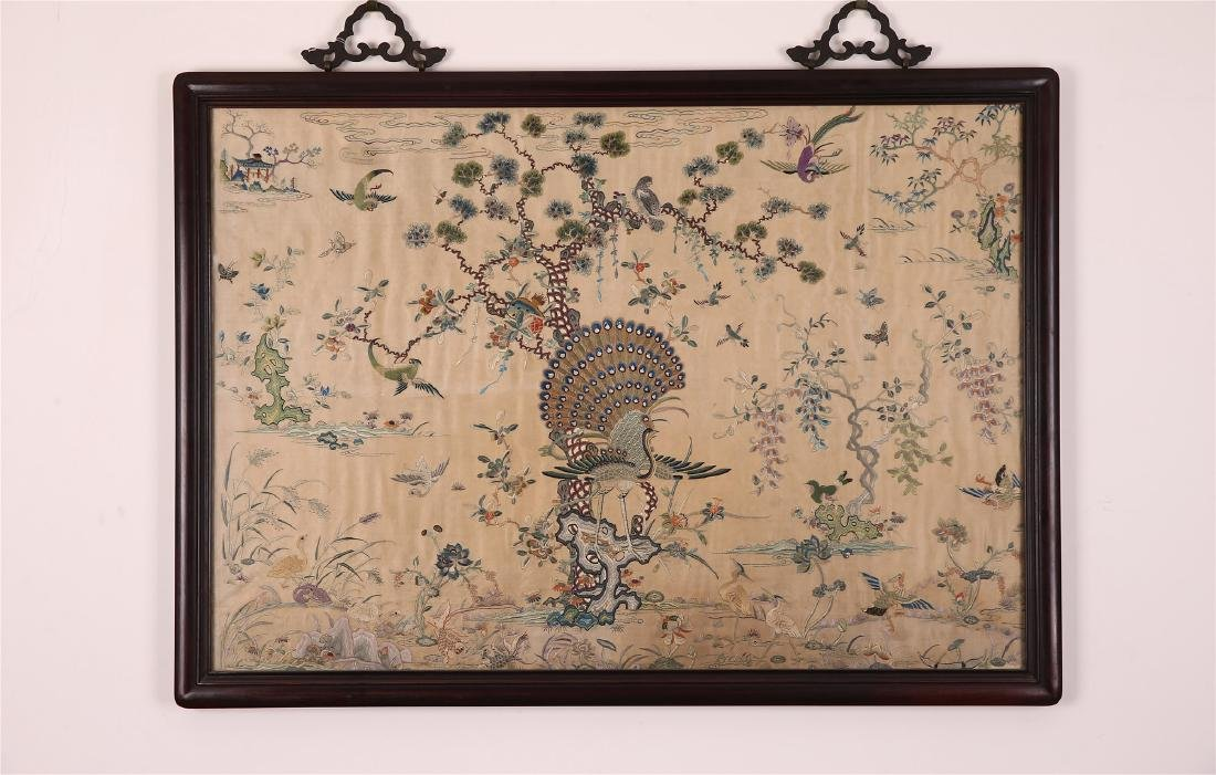 A CHINESE EMBROIDERED SILK PANEL FRAMED AND GLAZED