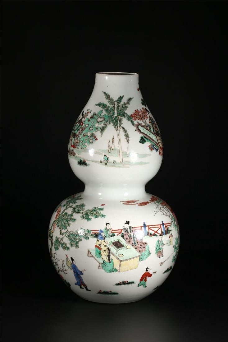 A CHINESE POLYCHROME PORCELAIN DOUBLE GOURD VASE