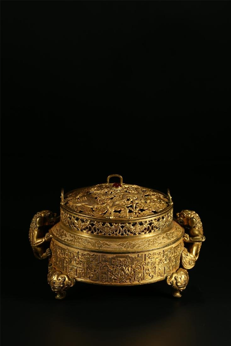 "A CHINESE GILT BRONZE ""DRAGON & PHOENIX"" CENSER AND"
