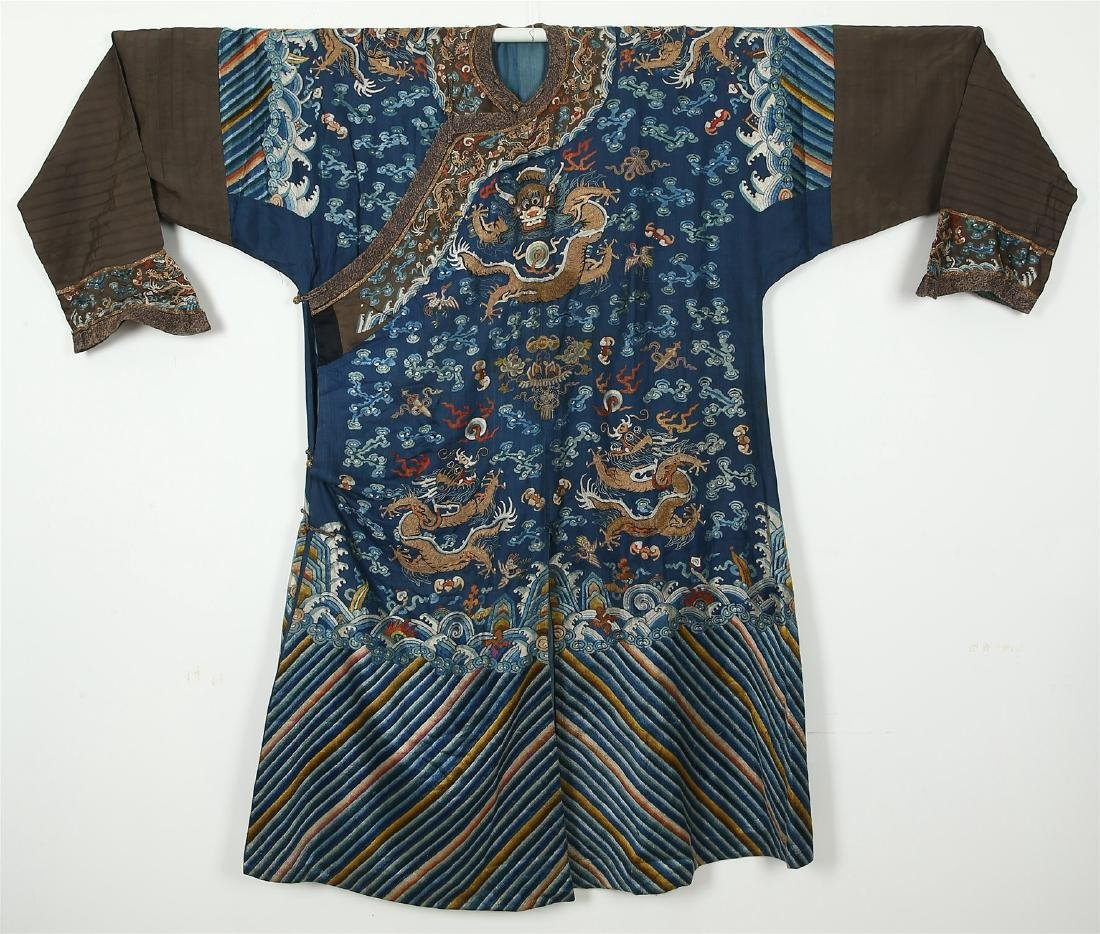 A CHINESE BLUE GROUND EMBROIDERED DRAGON ROBE