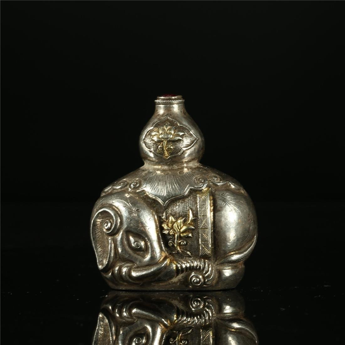 """A CHINESE SILVER """"ELEPHANT"""" SNUFF BOTTLE"""
