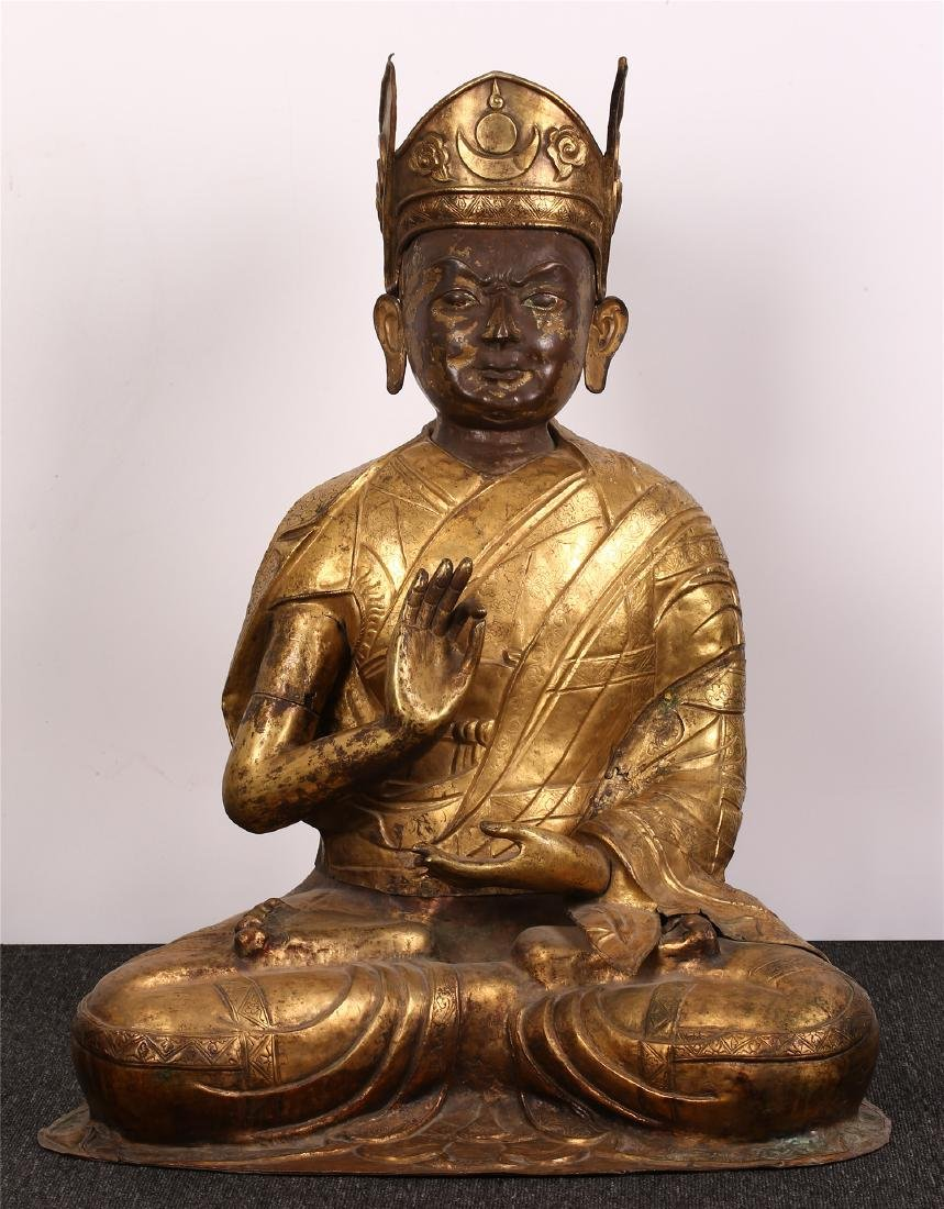 A CHINESE GILT BRONZE FIGURE OF A GURU