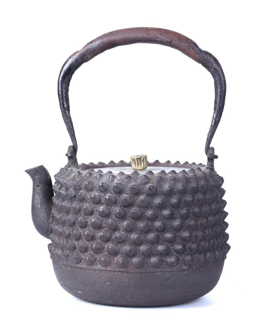 A JAPANESE CAST IRON TEA POT