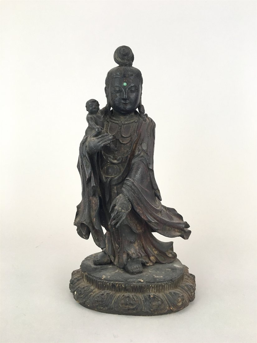 A CHINESE SANDALWOOD FIGURE OF GUANYIN AND CHILD