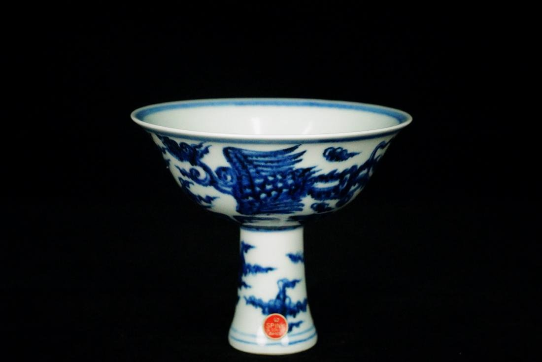 A CHINESE UNDERGLAZE BLUE AND WHITE PORCELAIN STEM BOWL