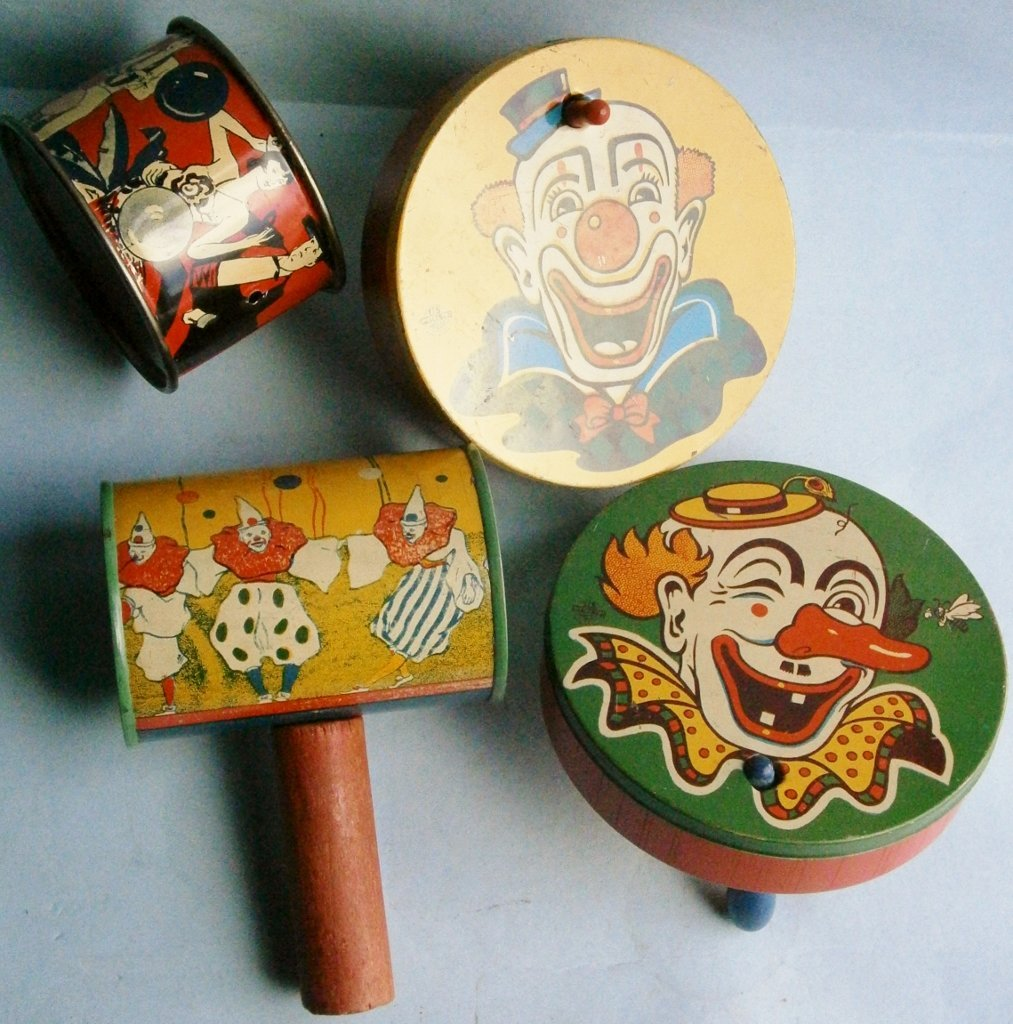 4 Lithographed tin toy noise makers