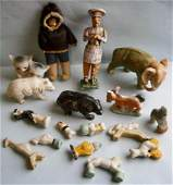 Group of porcelain figurines, Eskimo doll and others