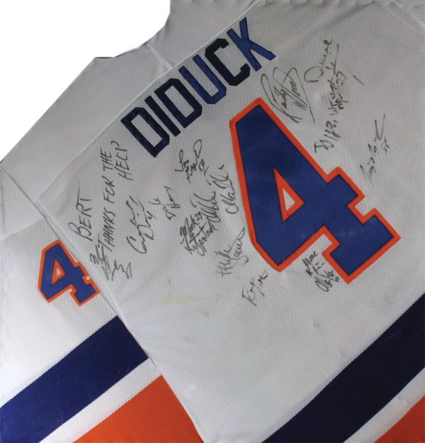 742: Signed Diduck jersey and Gretzky Helmet LOA