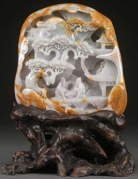 A Chinese Carved Jadeite Boulder