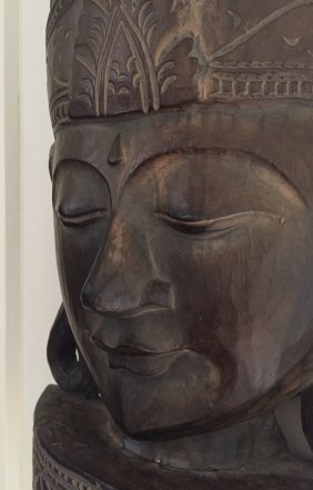 A Wood Carved Buddha Face
