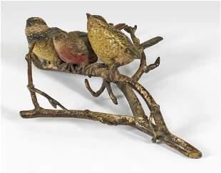 Vogelgruppe auf einem Zweig