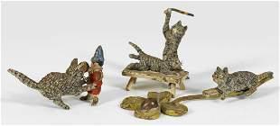 Drei MiniaturKatzenfiguren