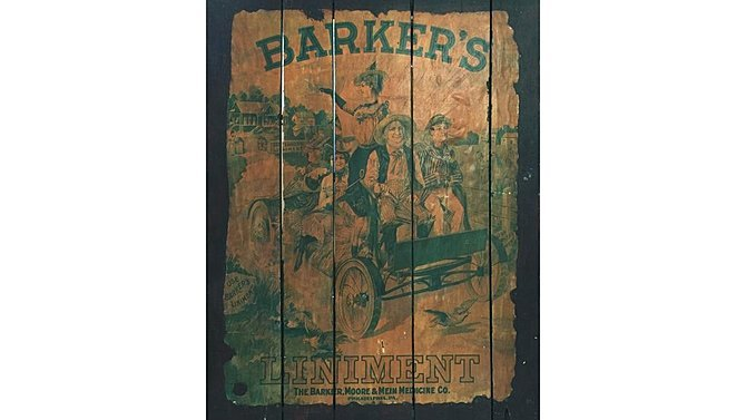 J16 -  Barkers Liniment Poster On Wood