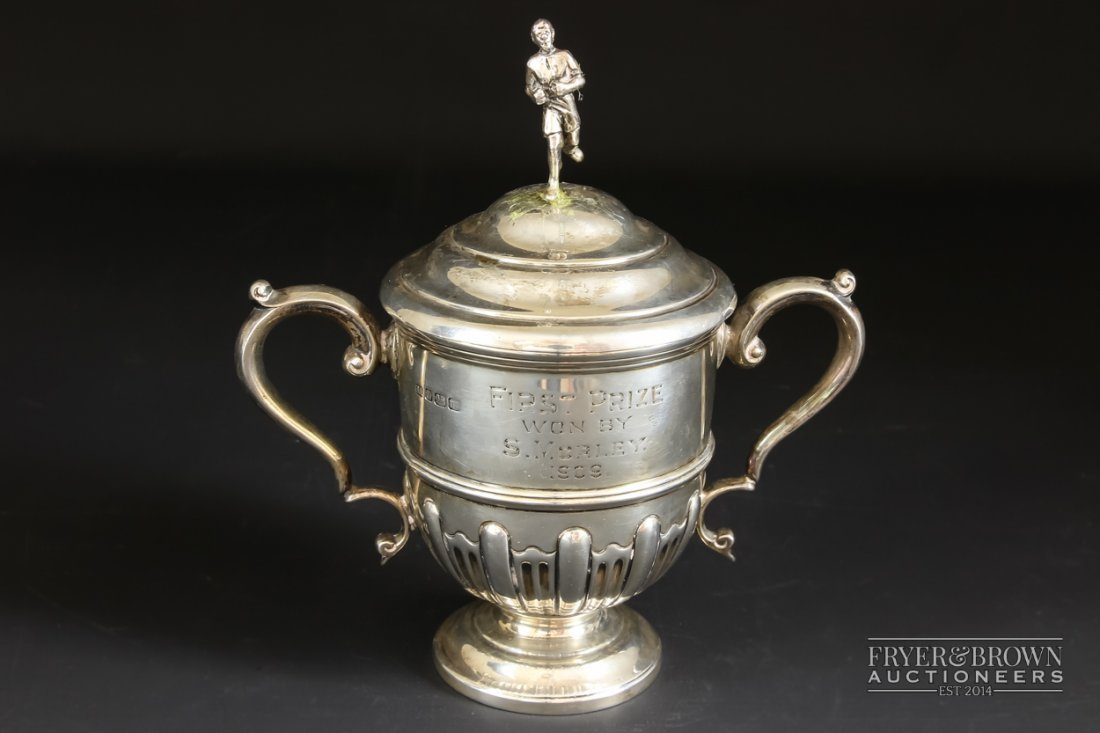 A silver trophy cup & cover, of typical form with