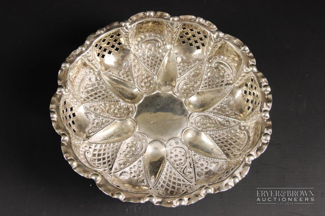 A silver pierced and embossed bonbon dish, circular, on