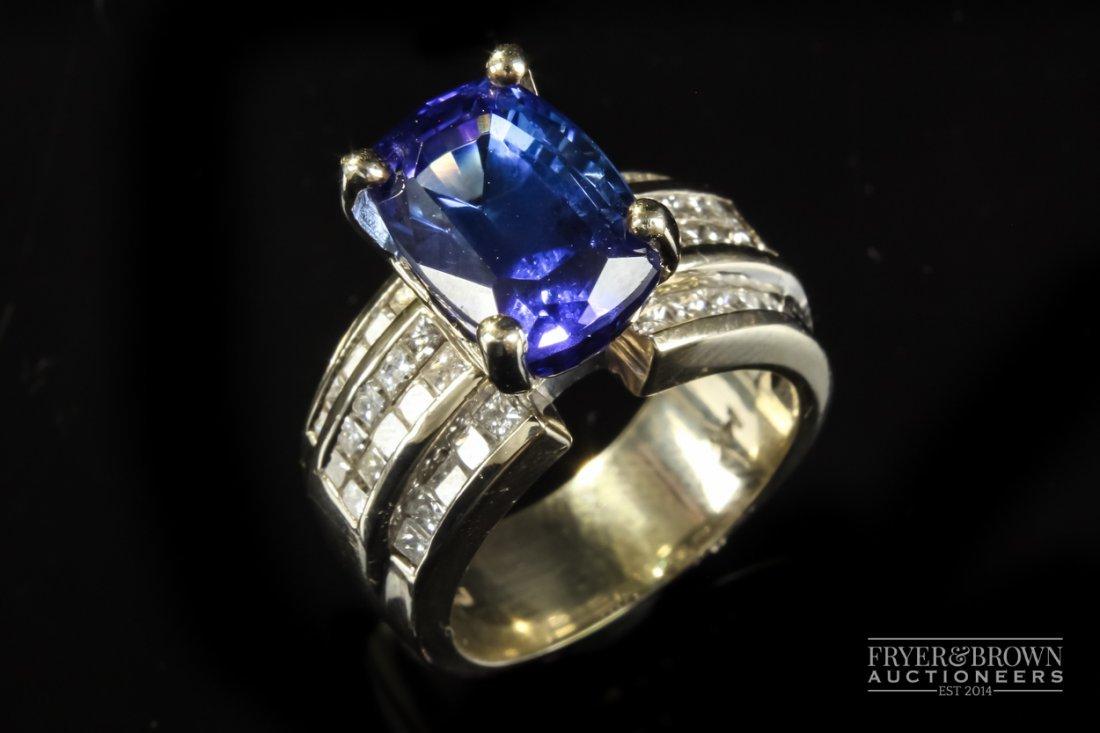 A tanzanite and diamond dress ring, the oval mixed cut