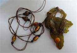 An antique Art Nouveau horn pendant in the style of