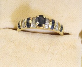A Sapphire, Calibre Cut Sapphire And Diamond Dress Ring