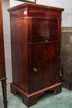 A Mid-20th Century Mahogany Pot Cupboard, With Roll
