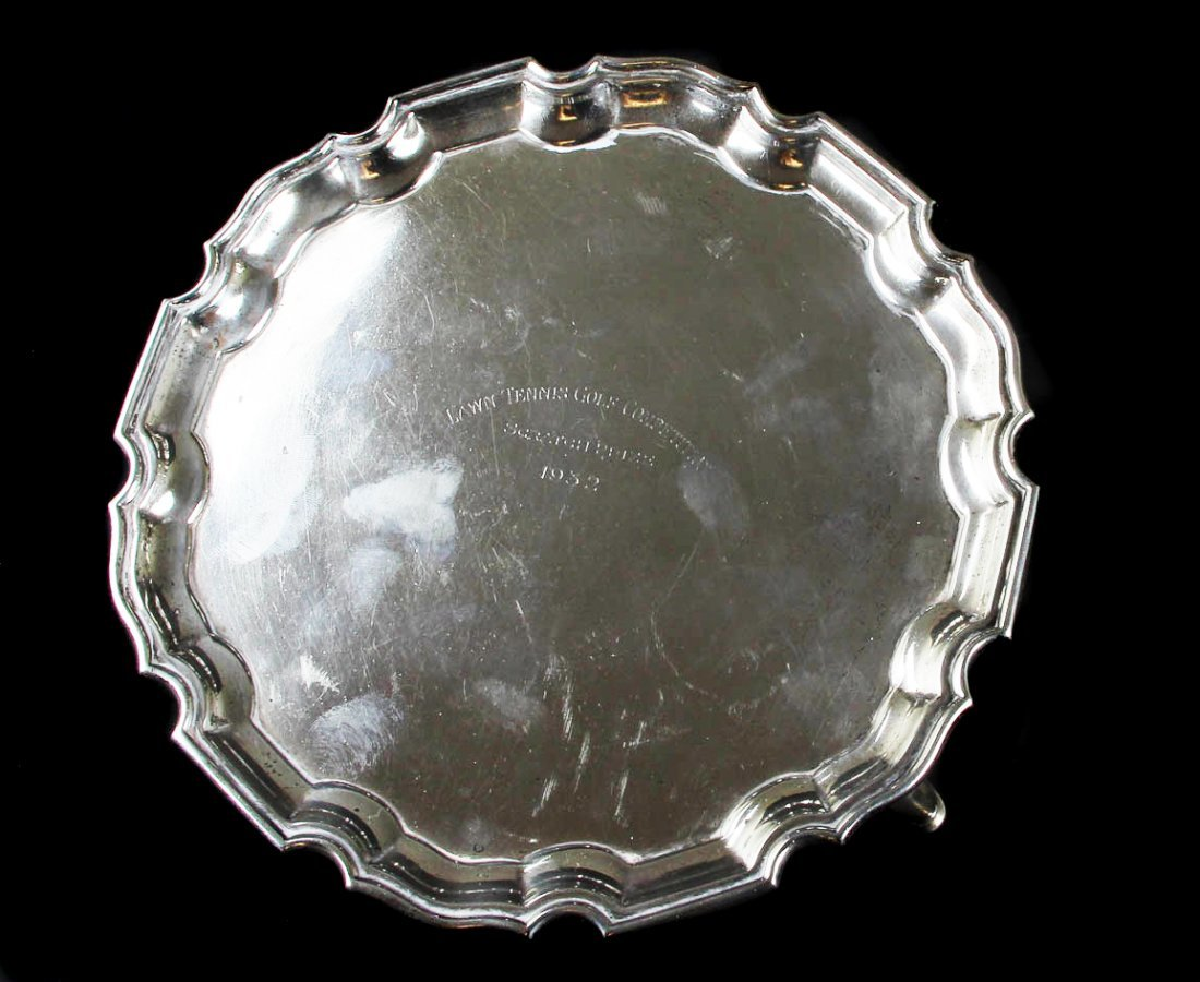 A Mappin & Webb silver salver, on tripod hoof feet,