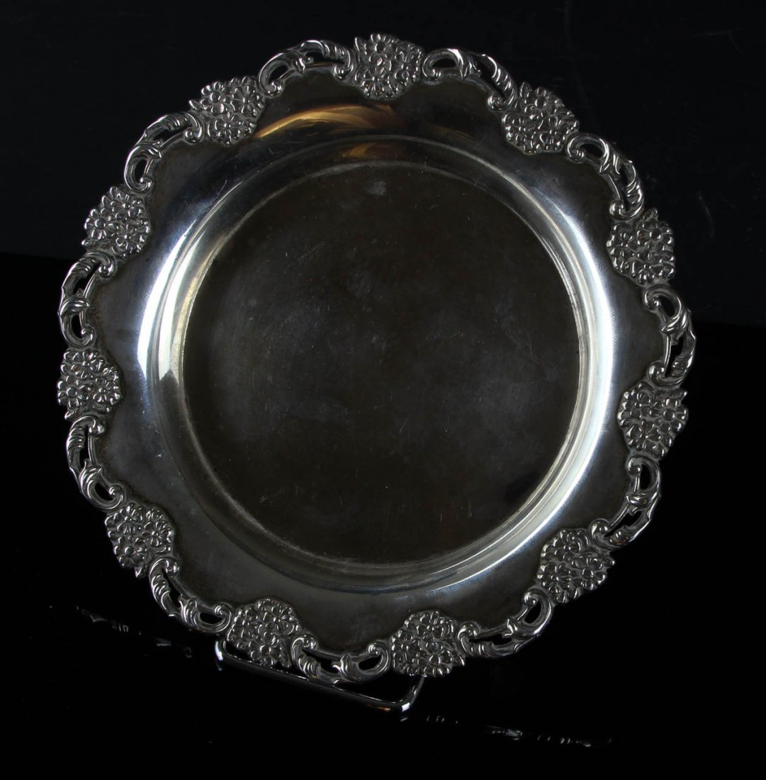 A sterling silver card tray, circular with a pierced