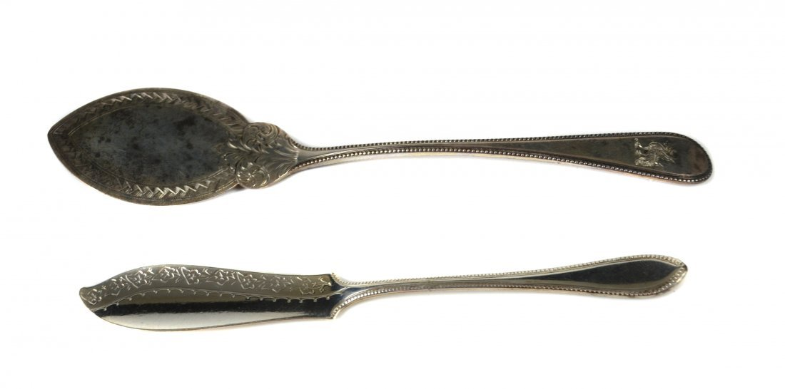 A crested silver flat blade jam spoon, the elliptical