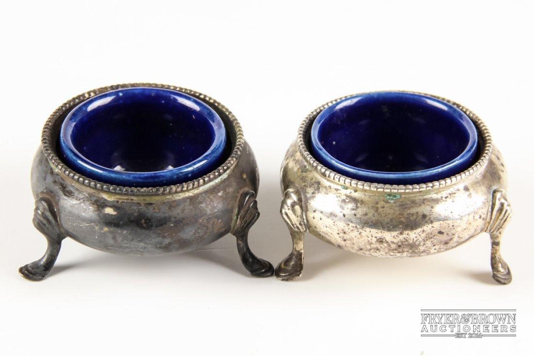 A pair of Victorian circular silver salts, each on