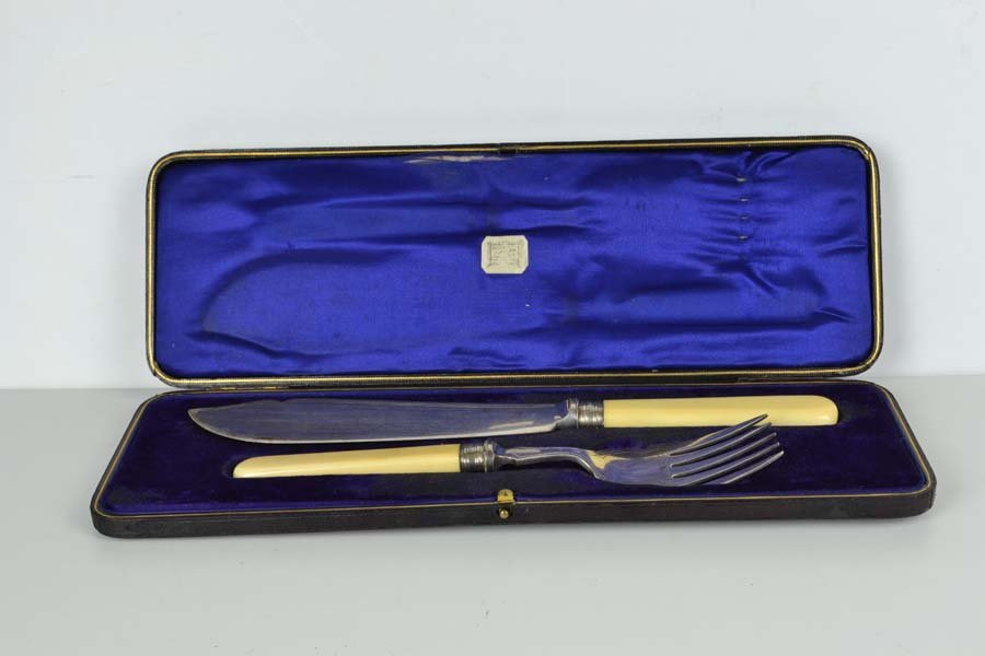 A cased pair of silver plated fish servers, with silver