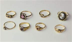 A group of eight gem set and gold rings, including a