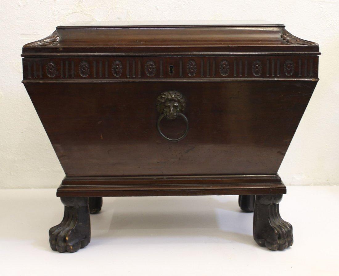 A Irish Regency mahogany veneered cellarette, with