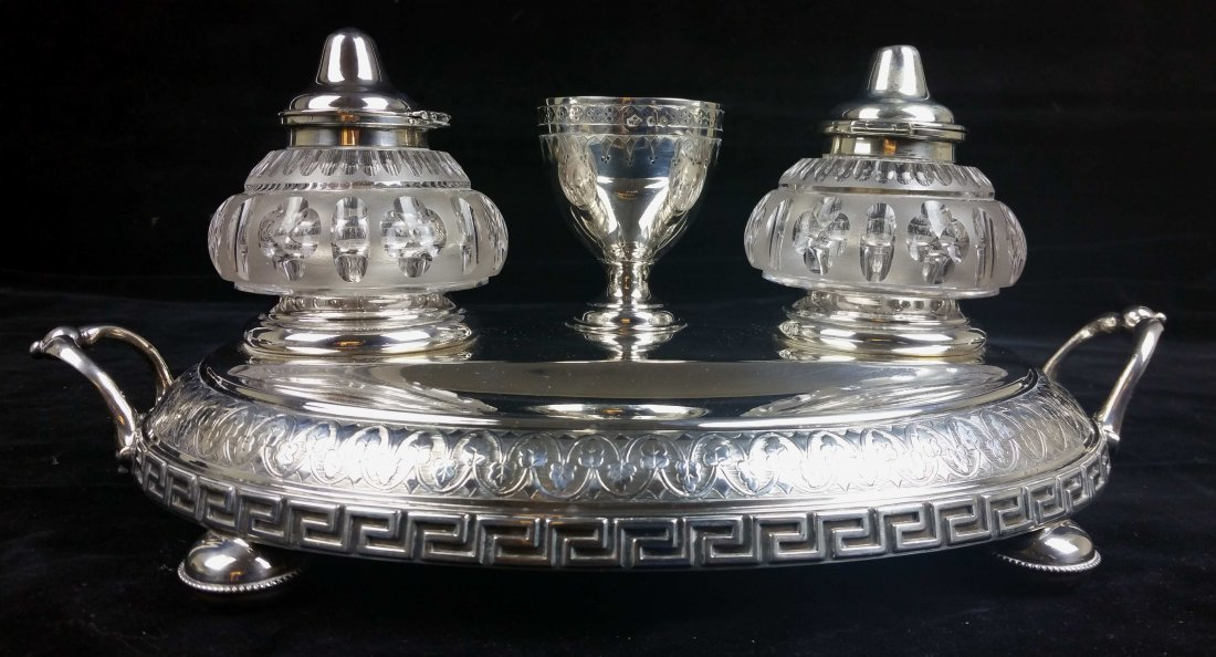A silver two handled inkstand, oval on four beaded
