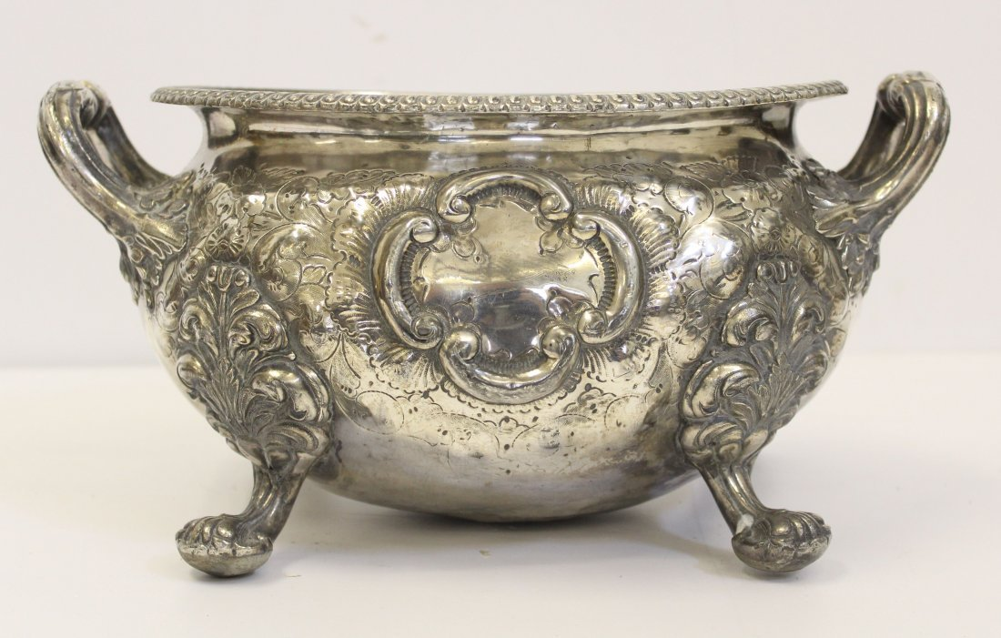 A silver plated oval footed jardinière or tureen, on