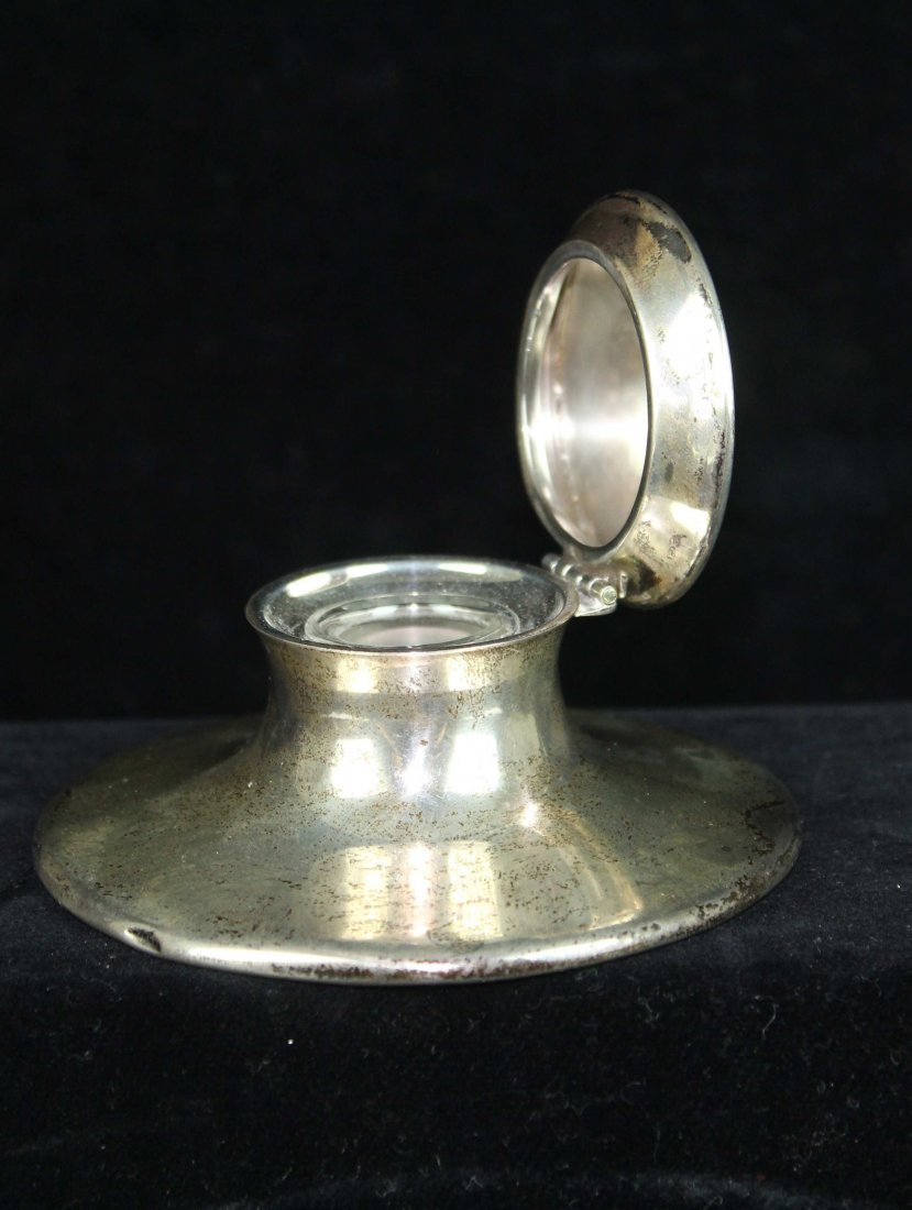 A small silver capstan form inkwell, circular,