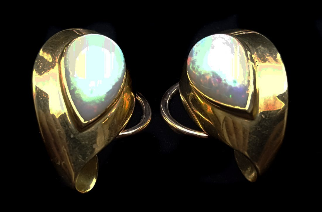 A pair of 1950's opal and yellow gold ear clips, of
