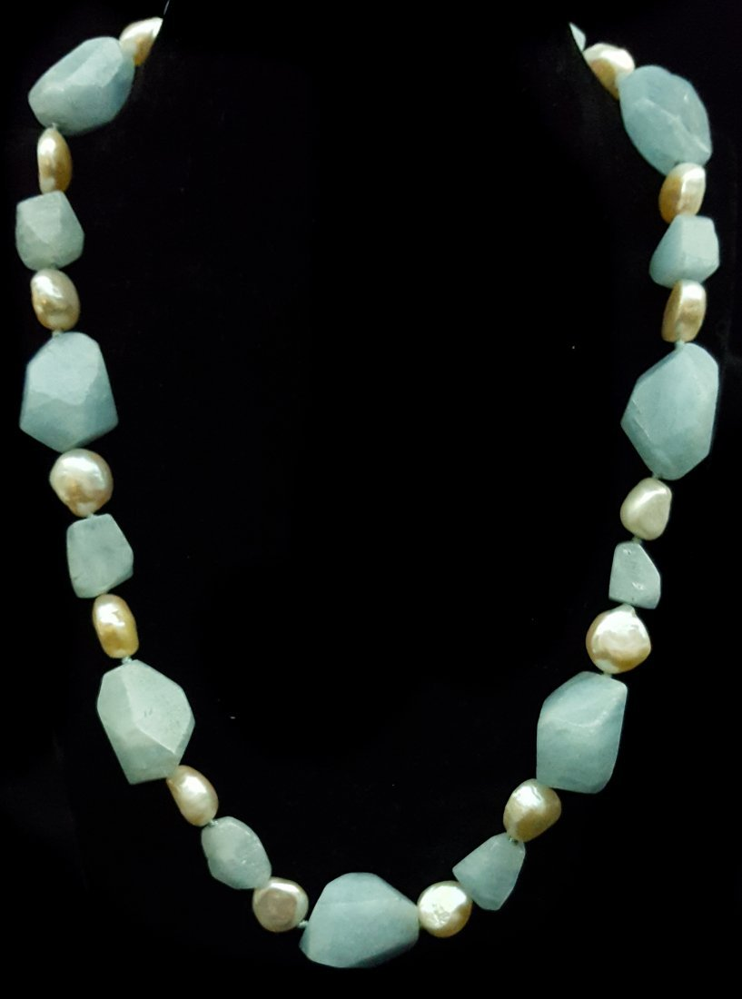 An unusual faceted pale blue quartz and cultured pearl