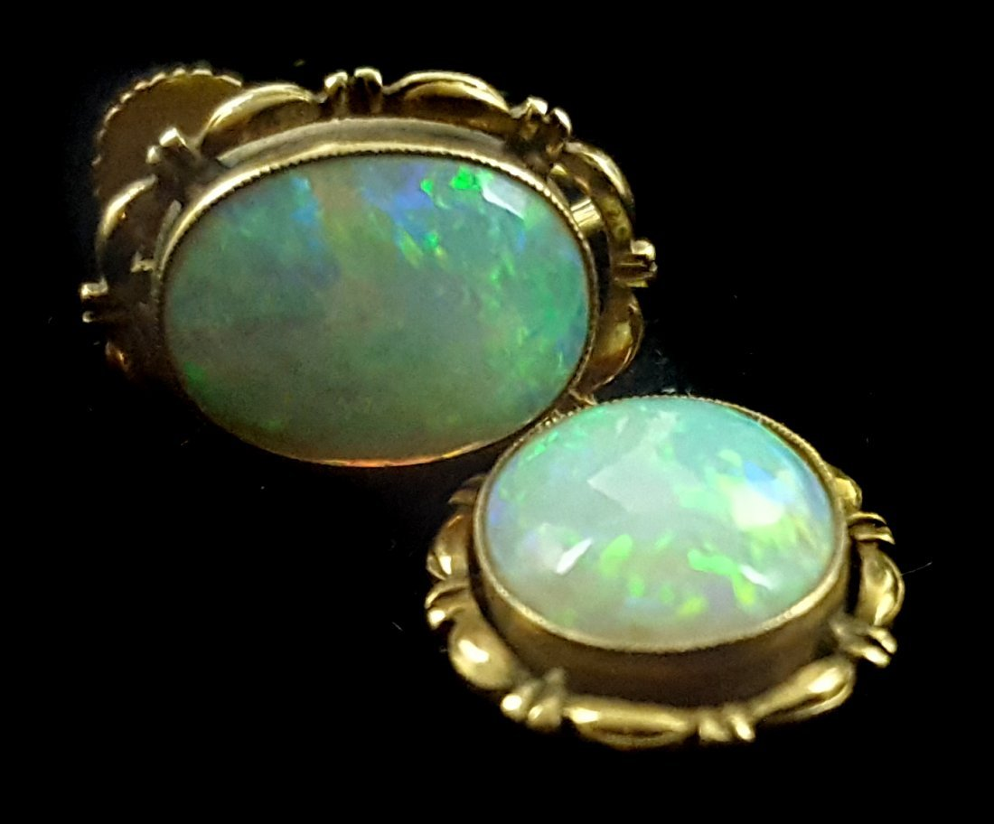 A pair of 1920's harlequin opal and yellow gold single