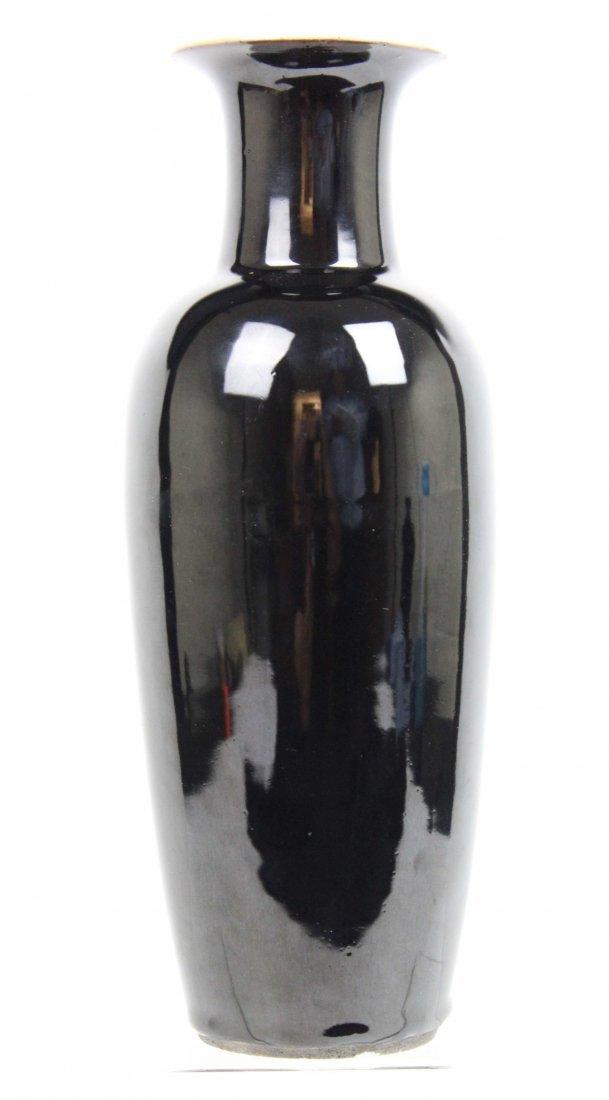 A Chinese porcelain monochrome vase, black glaze,