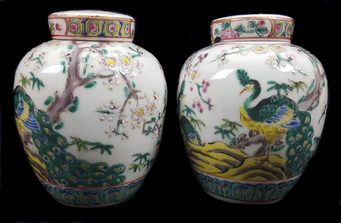 A pair of Chinese porcelain style pot pourri jars and