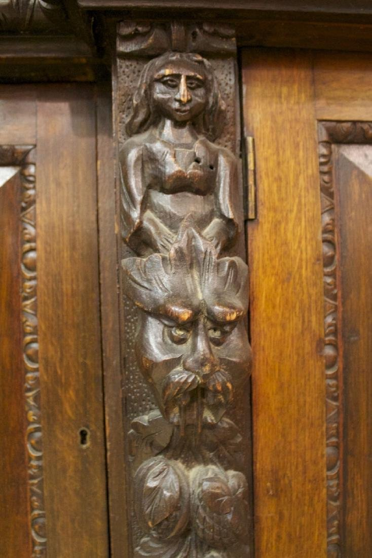 A Continental Carved Oak Bookcase, 19th century - 10