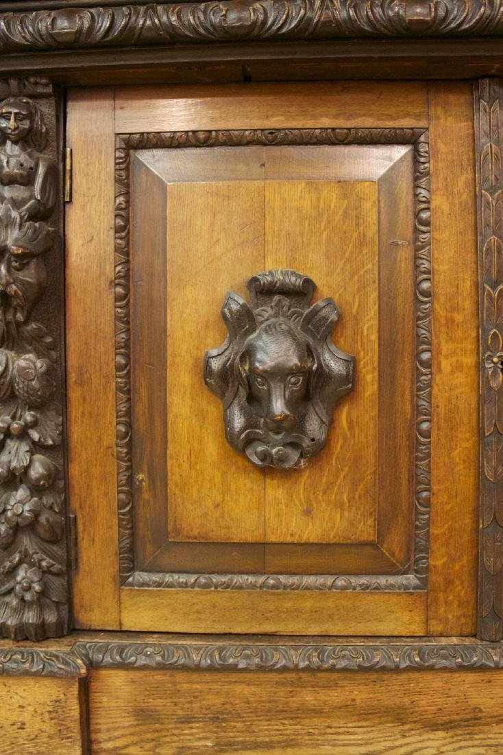 A Continental Carved Oak Bookcase, 19th century - 9