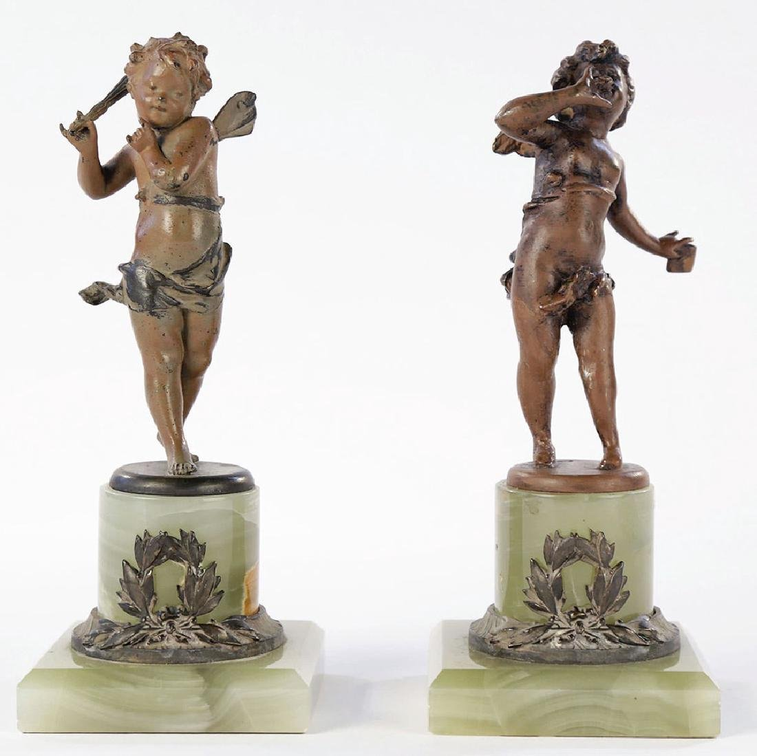 A Pair of Cold Painted Bronze Cherubs on Onyx Bases