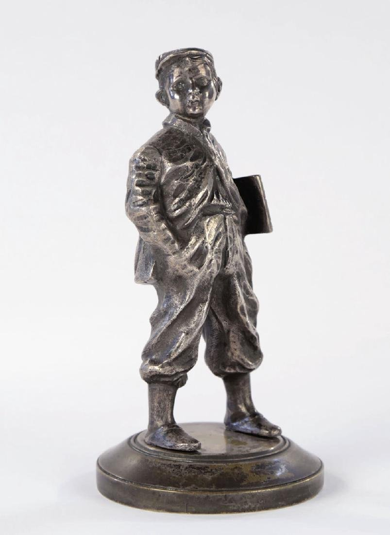 A Silvered Bronze Figure of a Newsboy, 19th Century