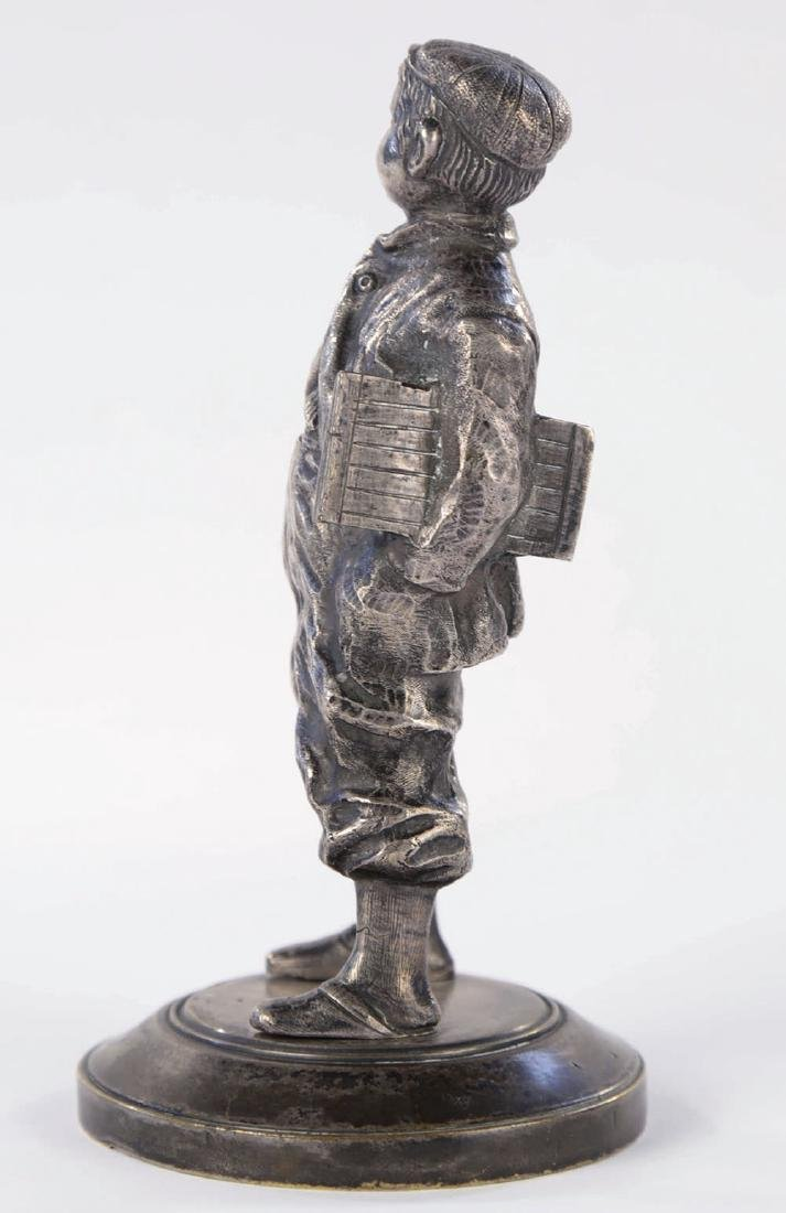 A Silvered Bronze Figure of a Newsboy, 19th Century - 2