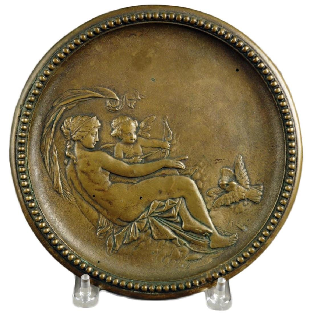 A Cast Brass Plaque depicting Venus and Cupid